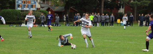 Evan Crocker (2 goals) dribbles past Curry GK Dan Johnson and into an clear look at the Curry goal.
