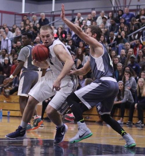 Sam Johnson (17 points/11 rebounds) led Gordon past Lesley