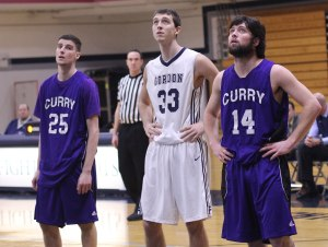 Ryan Beatty (25), Steven Vampatella (33), and Luke Schreiner (14) eye a free throw