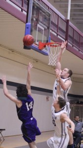 Sam Johnson goes for a block against Luke Schreiner