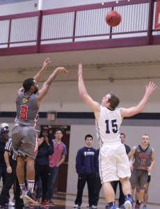 Jaylen Owens shoots over Jake Hart