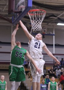 Eric Demers denied Max Motroni's breakaway layup with a hustling block