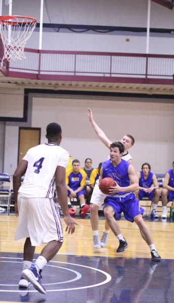 Austin Coene (22 points) gets into the paint