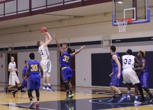 Eric Demers (16 points) shoots over Alex Santos