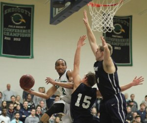 Kemahl Walker gets in the air looking to pass around Jake Hart and Sam Johnson