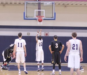 Richie Armand shoots a free throw in the last minute