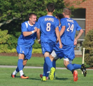 Sean Janson congratulated by teammates after first-half goal
