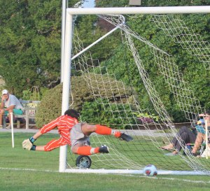 Edmund Geschickter dives for Caleb Cole's PK attempt