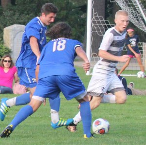 Garrett Bolton steps on Caleb Cole's foot in the penalty area