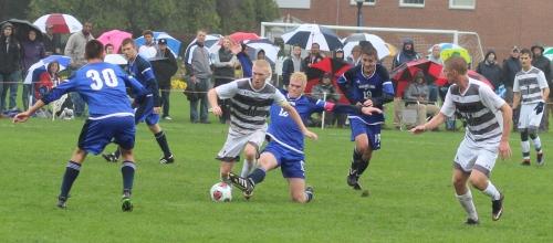 Erik Holmqvist (12) tries to stop Caleb Cole.