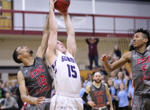 Jake Hart (#15) latches onto the final rebound between Christian Lynch (12) and Patrick Michel (5)