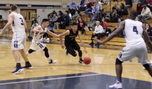 Marcos Echevarria (25 points) penetrates the Gordon defense